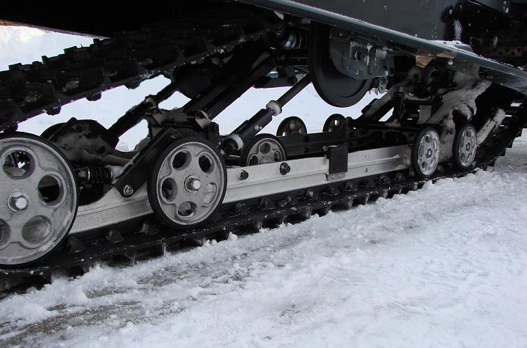 Регулировка гусеницы снегохода
